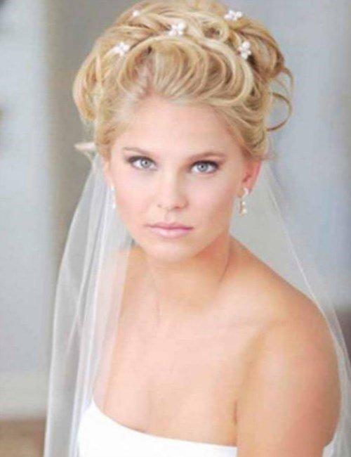 Свадебные прически низкий пучок с фатой фото